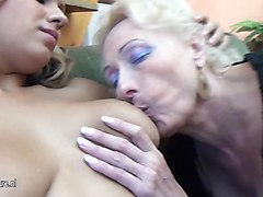 Lesbian, Two mature lesbians strapon fuck girl